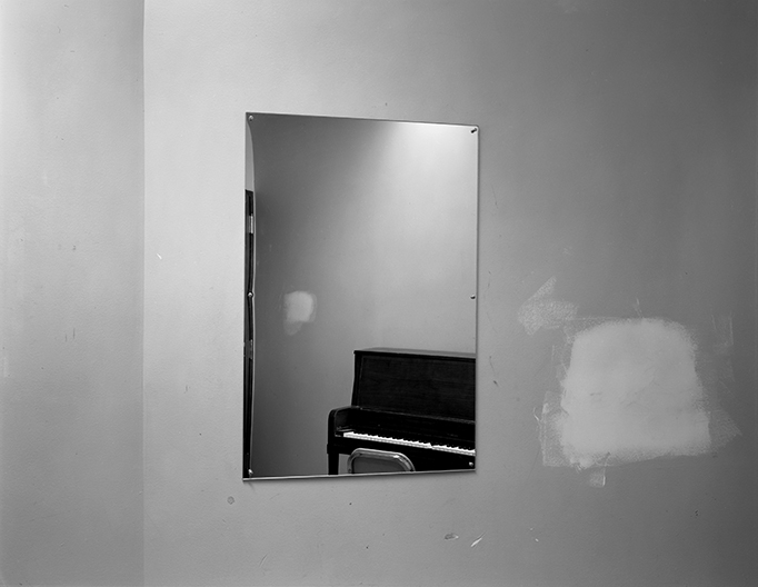 Lynne Cohen - Untitled (mirror with piano and smudge), 1980-1989