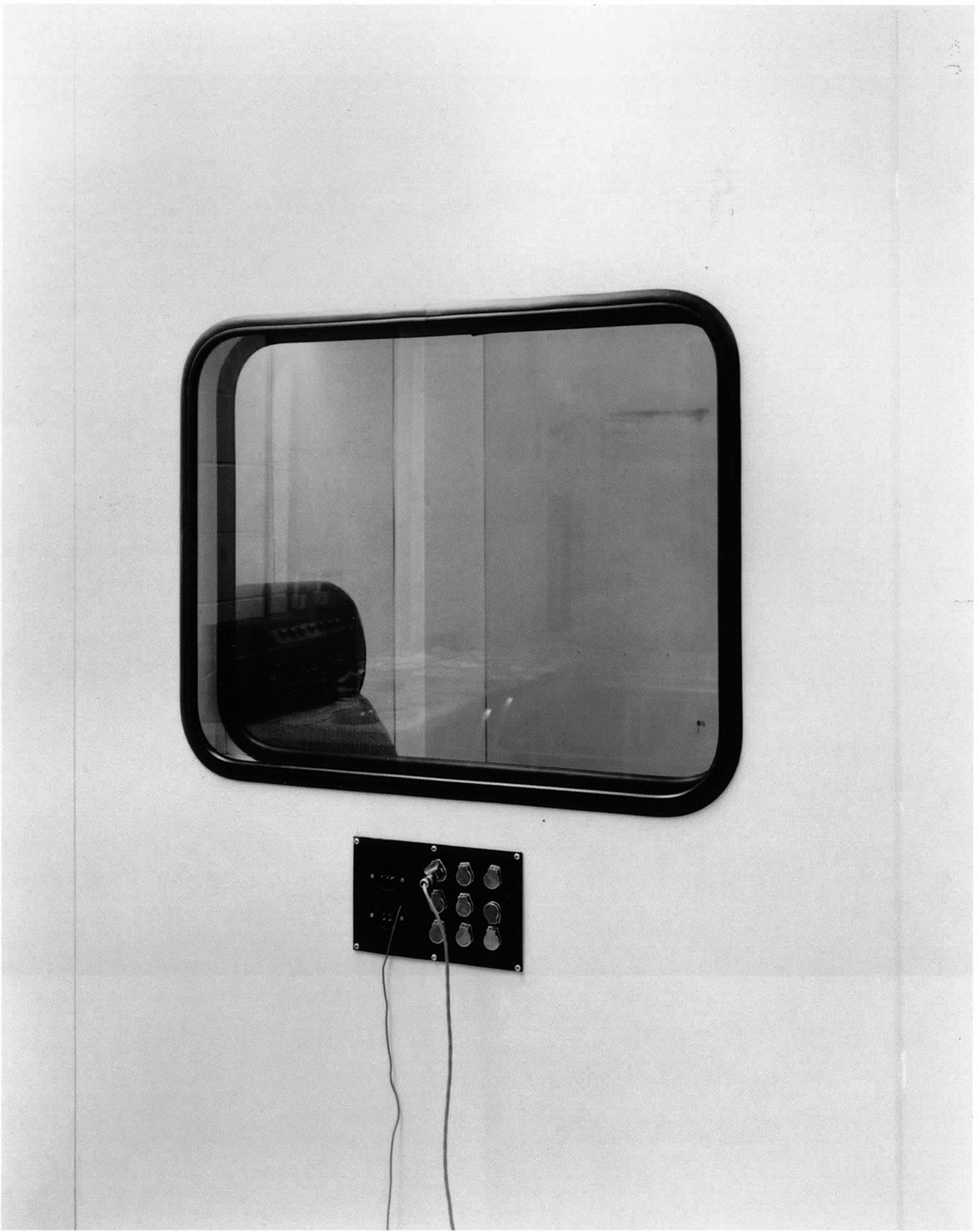 Lynne Cohen - Untitled (acoustic window with chair), 1980's